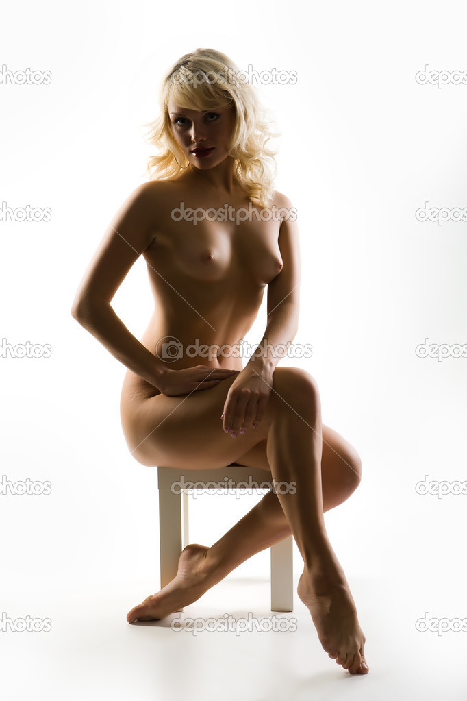Young Blonde Nude Woman Sitting On A Chair