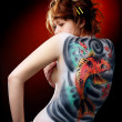 The girl and the red carp (body art) — Stock Photo #3342451