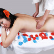 Stock Photo: Nude Chinese girl getting massage.