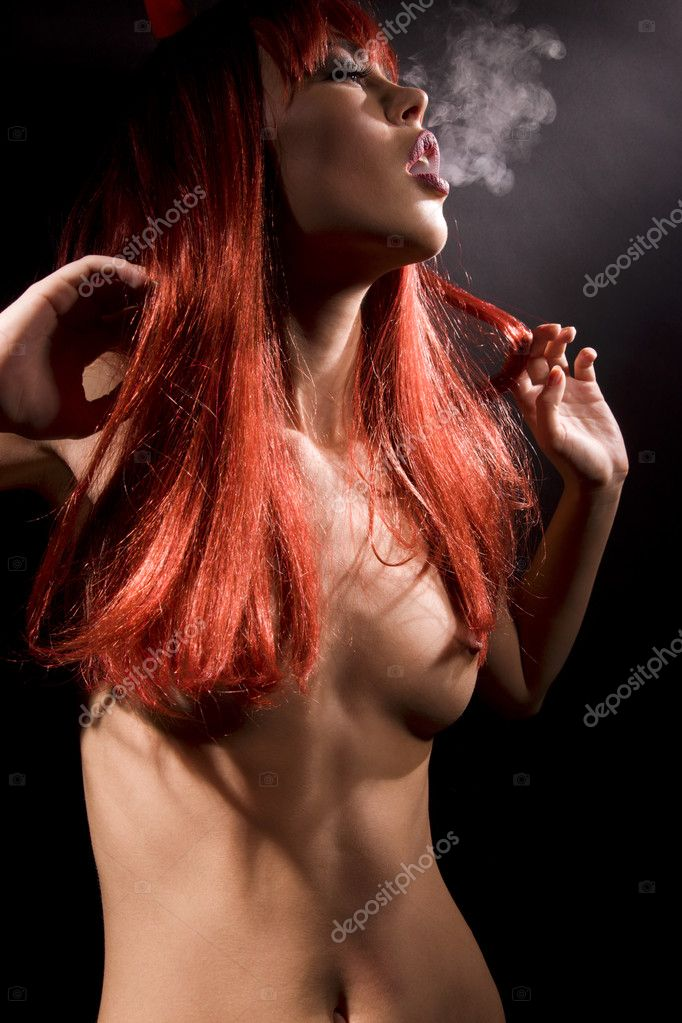 Dark picture of smoking naked devil woman — Stock Photo #3256093