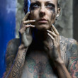 Naked tattooed woman - Stock Photo